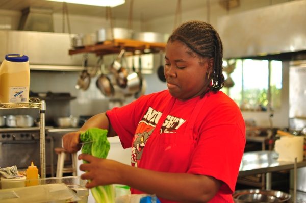 Nikoya Taylor working in the kitchen